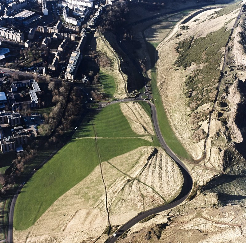 Oblique aerial view of Holyrood Park centred on the remains of cultivation, taken from the ESE.