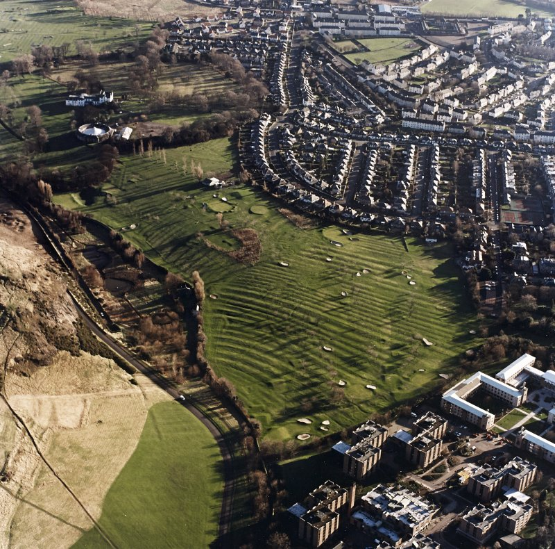 Oblique aerial view of Prestonfield centred on a golf course and rig, taken from the SSW.