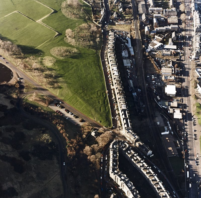 Oblique aerial view of Holyrood Park centred on possible air raid shelters, taken from the E.