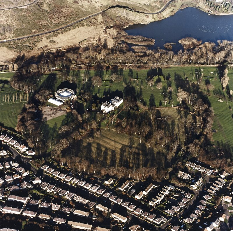 Oblique aerial view of Prestonfield centred on a golf course and rig with Prestonfield House and stables adjacent, taken from the SW.