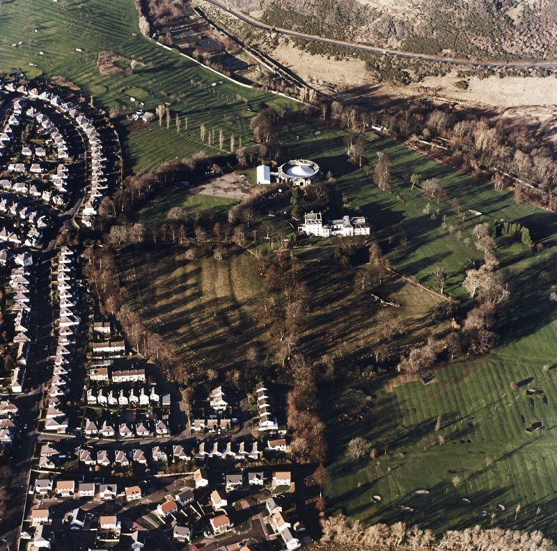 Oblique aerial view of Prestonfield centred on a golf course and rig with Prestonfield House and stables adjacent, taken from the SE.