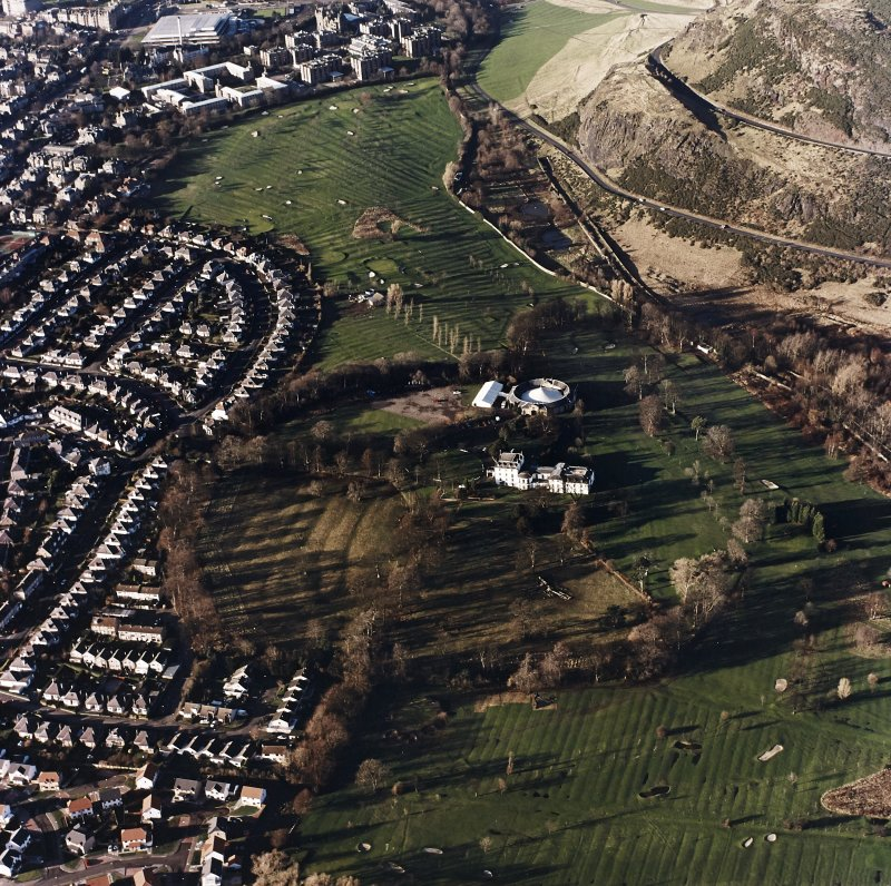 Oblique aerial view of Prestonfield centred on a golf course and rig with Prestonfield House and stables adjacent, taken from the ESE.