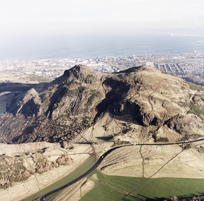 Oblique aerial view of Edinburgh, Holyrood Park centred on the remains of cultivation terraces and Arthur's Seat, taken from the WSW.