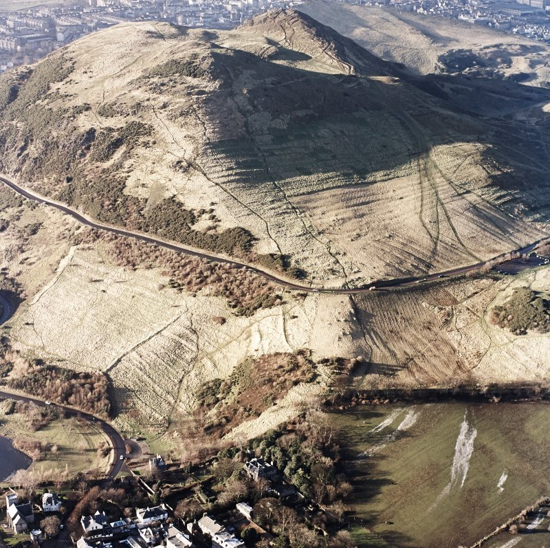 Oblique aerial view of Edinburgh, Holyrood Park centred on the remains of cultivation terraces, taken from the SE.