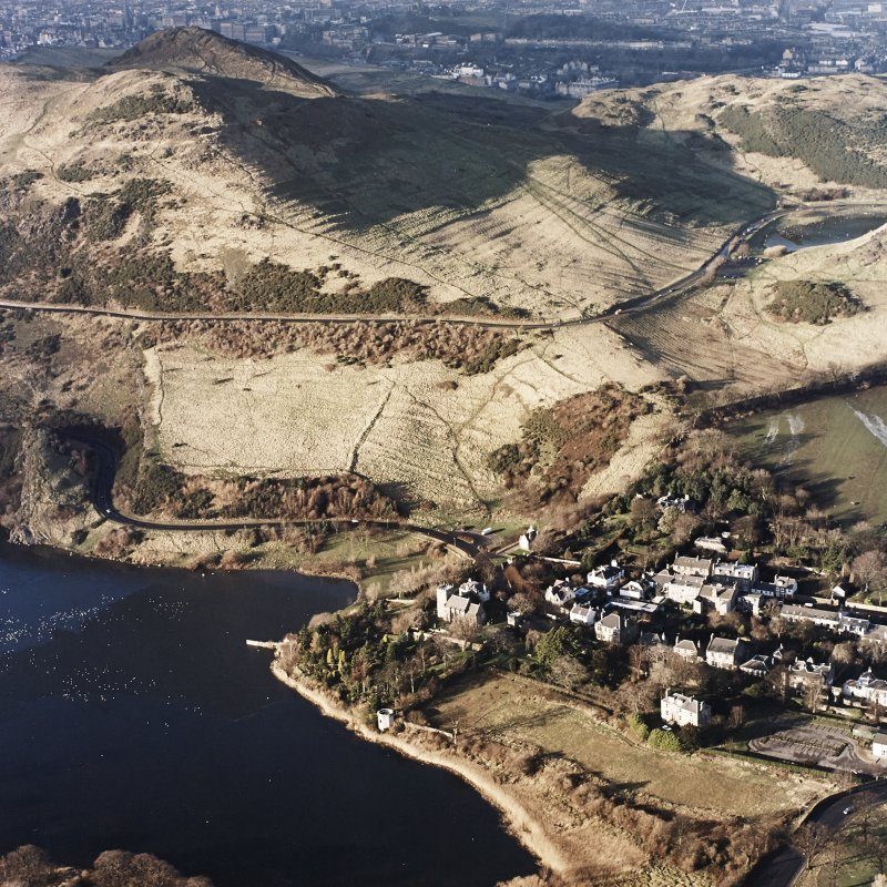 Oblique aerial view of Edinburgh, Holyrood Park centred on the remains of cultivation terraces, taken from the ESE.