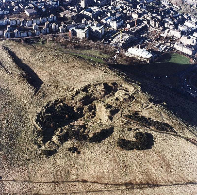 Oblique aerial view of Holyrood Park centred on the remains of quarries, taken from the ESE.