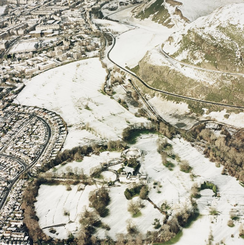 Oblique aerial view of Edinburgh, centred on Holyrood Park, taken from the SE.