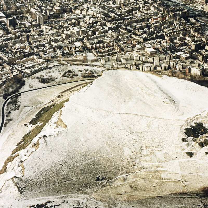 Oblique aerial view of Edinburgh, centred on Holyrood Park, taken from the E.