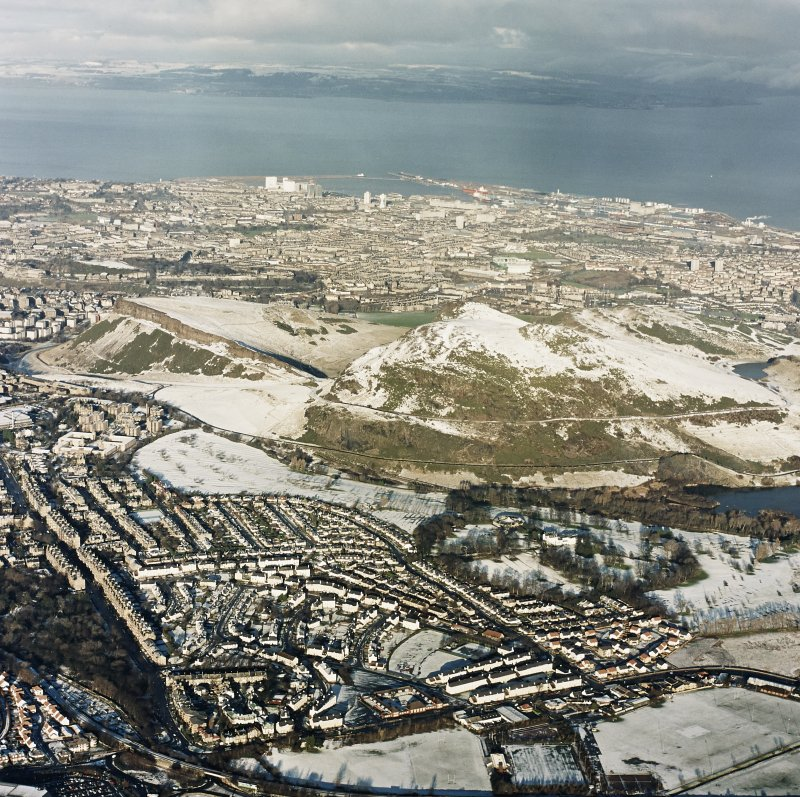 Oblique aerial view of Edinburgh, centred on Holyrood Park, taken from the SSE.