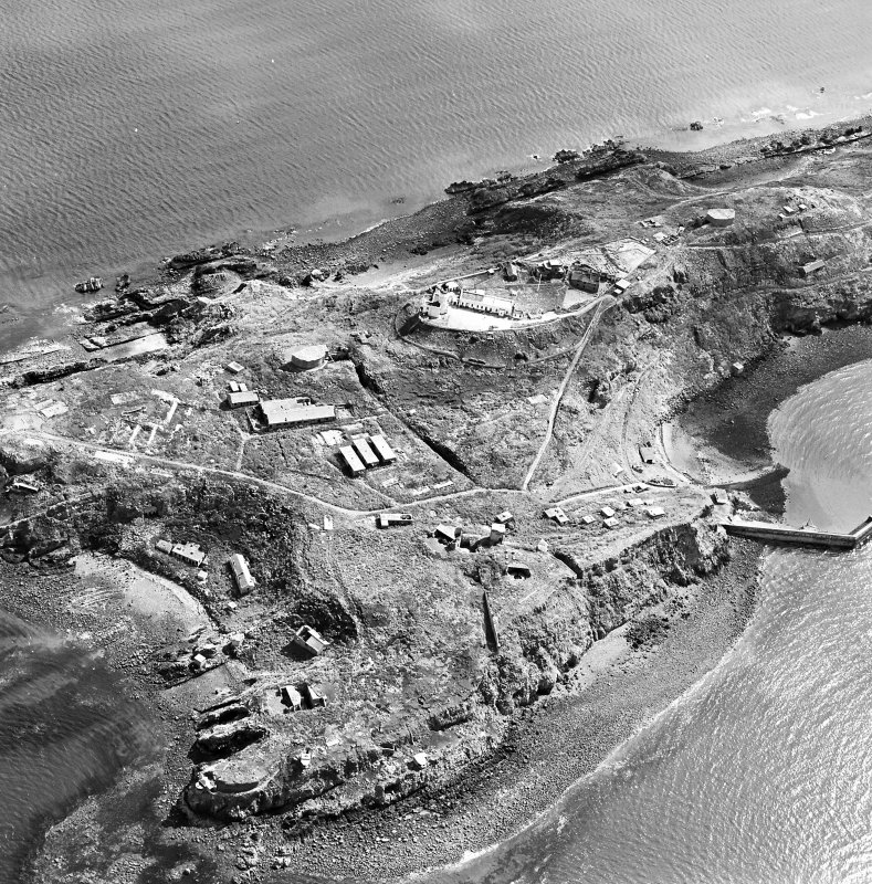 Oblique aerial view of Inchkeith Island centred on the defences, taken from the WNW.