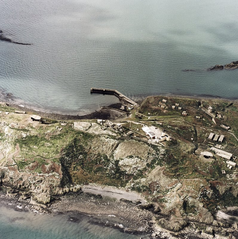 Oblique aerial view of Inchkeith Island centred on the defences, taken from the NE.