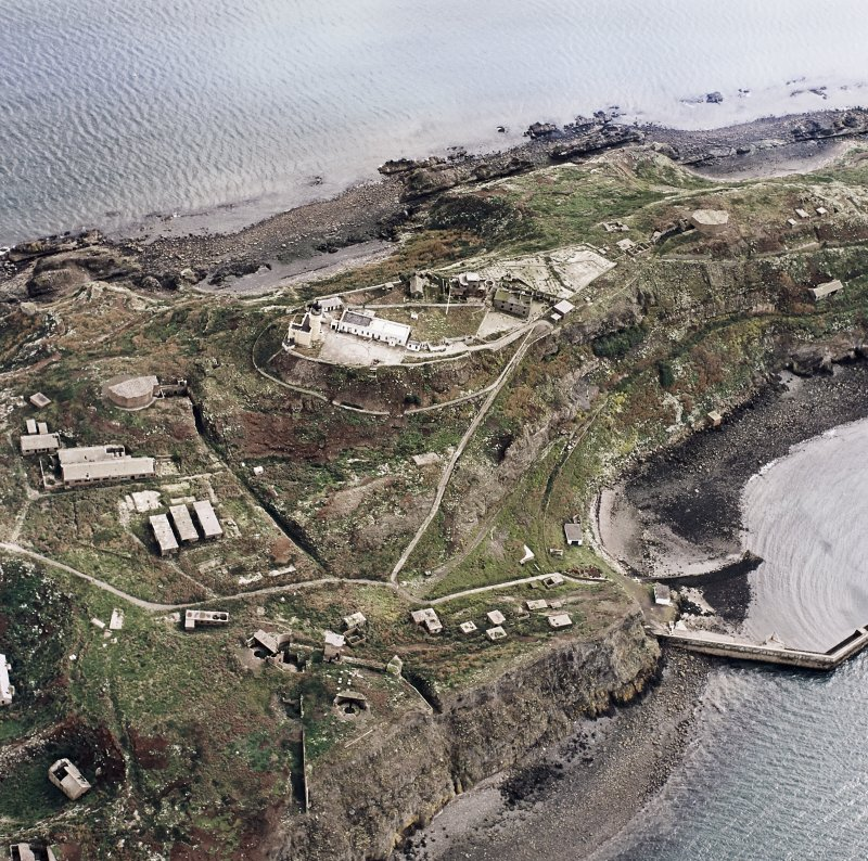 Oblique aerial view of Inchkeith Island centred on the defences, taken from the W.