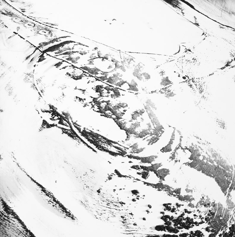 Kirktonhill, oblique aerial view, taken from the WNW, centred on the snow-covered fort.