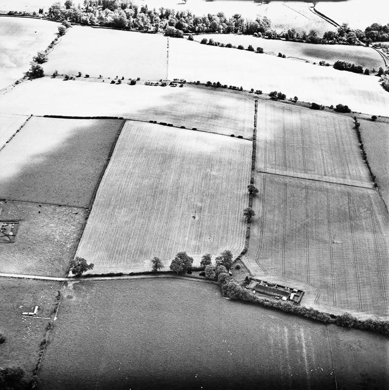 Milrighall, oblique aerial view taken from the NW, centred on the cropmarks of a Roman Temporary Camp.