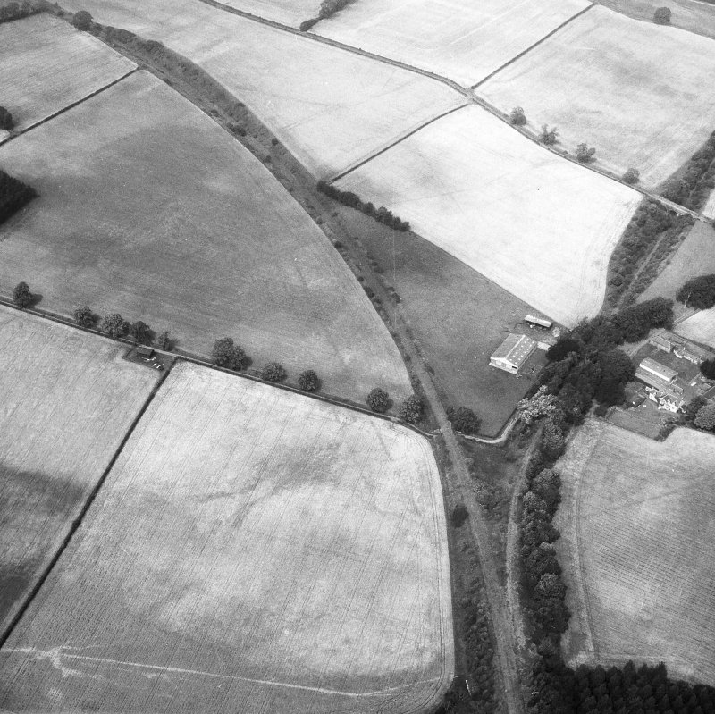 Newstead, Roman fort and temporary camps: air photograph showing fort (NT 569 344), Southern annexe (NT 569 341), Eastern annexe (NT 572 343), annexe (NT 571 343) and 'Great camp' complex of temporary camps (NT 574 341).
