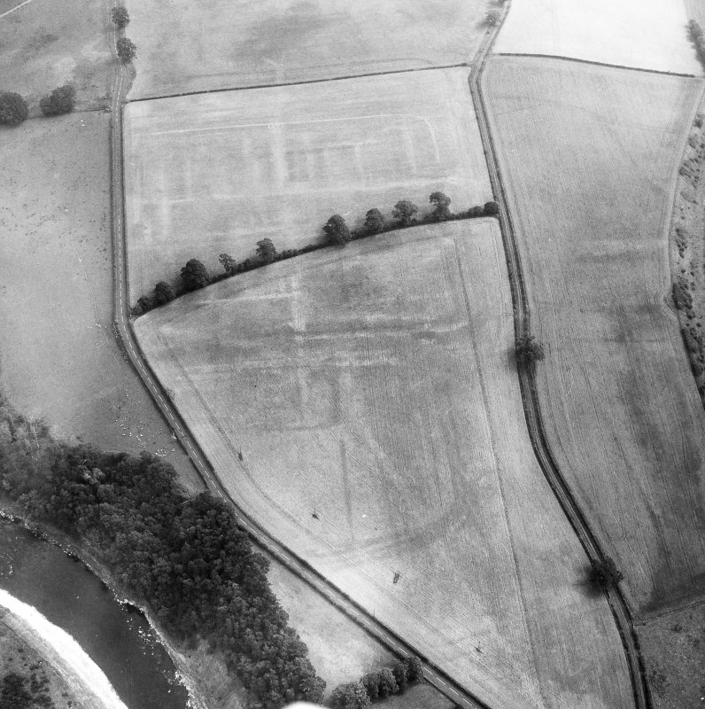 Newstead, Roman fort and temporary camps: air photograph showing fort (NT 569 344), Southern annexe (NT 569 341), Eastern annexe (NT 572 343), Western annexe (NT 567 343), annexe (NT 571 343), possible annexe (NT 570 346), and 160-acre temporary camp (NT 567 337).