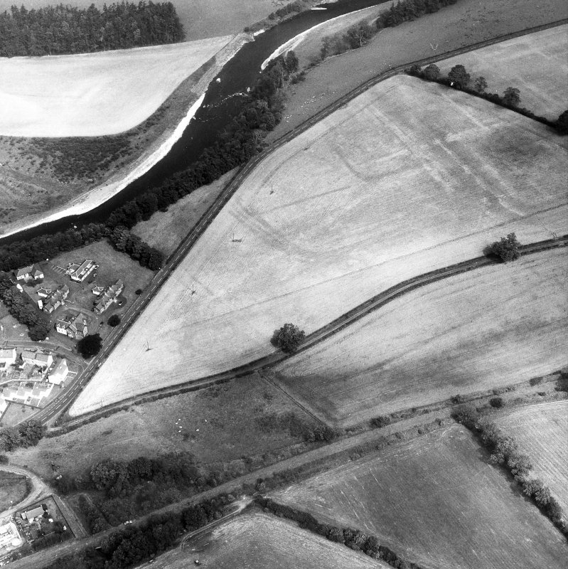 Newstead, Roman fort and temporary camps: air photograph showing fort (NT 569 344), Western annexe (NT 567 343), 160-acre temporary camp (NT 567 337) and linear feature (NT 565 341).