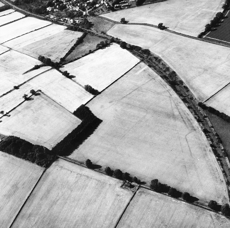 Newstead, Roman fort and temporary camps: air photograph showing Southern annexe (NT 569 341), 'Great camp' complex of temporary camps (NT 574 341), and 40- and 160-acre temporary camps (NT 570 337 and NT 570 344 respectively).
