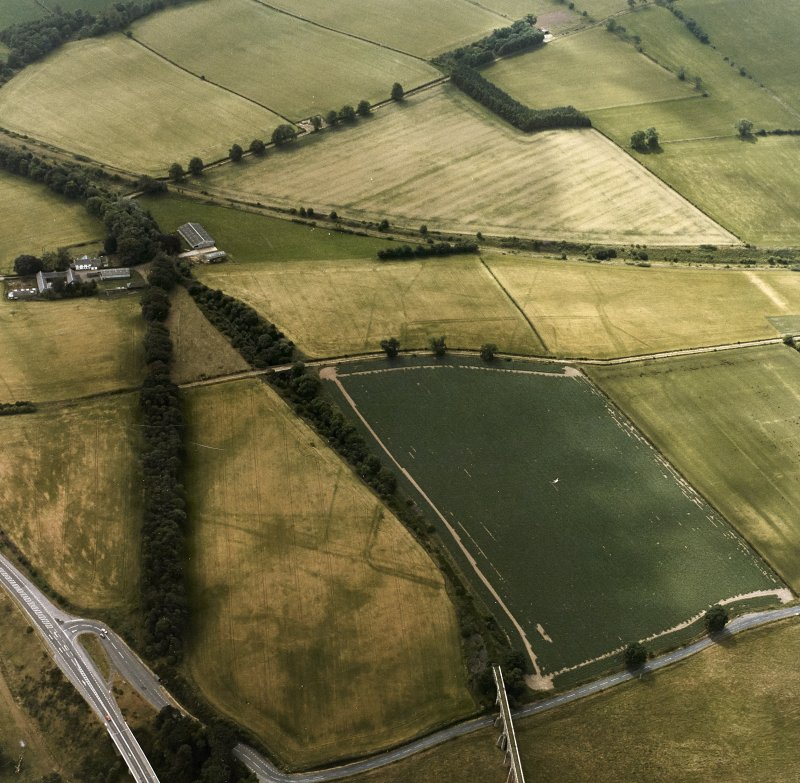 Newstead, Roman fort and temporary camps: air photograph showing Eastern annexe (NT 572 343), Southern annexe (NT 569 341), Western annexe (NT 569 341), annexe (NT 571 343), and possible annexe (NT 569 342).