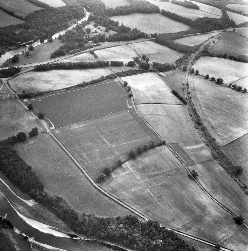 Newstead, Roman fort and temporary camps: air photograph showing Eastern annexe (NT 572 343), Southern annexe (NT 569 341), Western annexe (NT 569 341), annexe (NT 571 343) and possible annexes (NT 569 342 and NT 570 346).