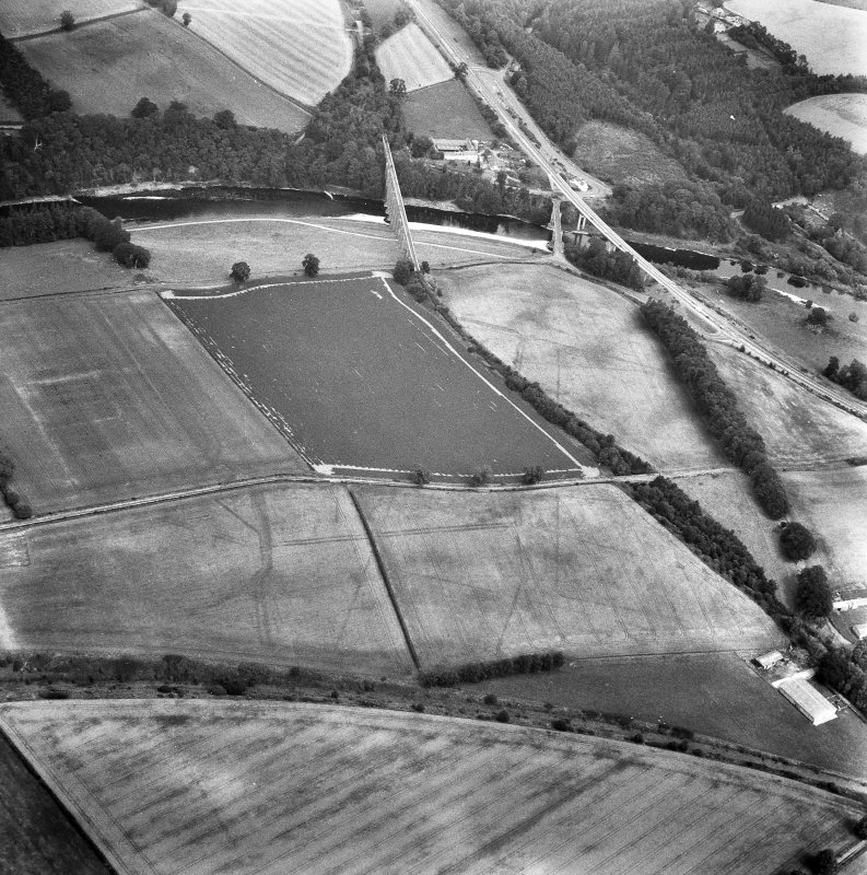 Newstead, Roman fort and temporary camps: air photograph showing Eastern annexe (NT 572 343), Southern annexe (NT 569 341), Western annexe (NT 569 341), annexe (NT 571 343), possible annexes (NT 569 342 and NT 570 346), and 160-acre temporary camp (NT 567 337).