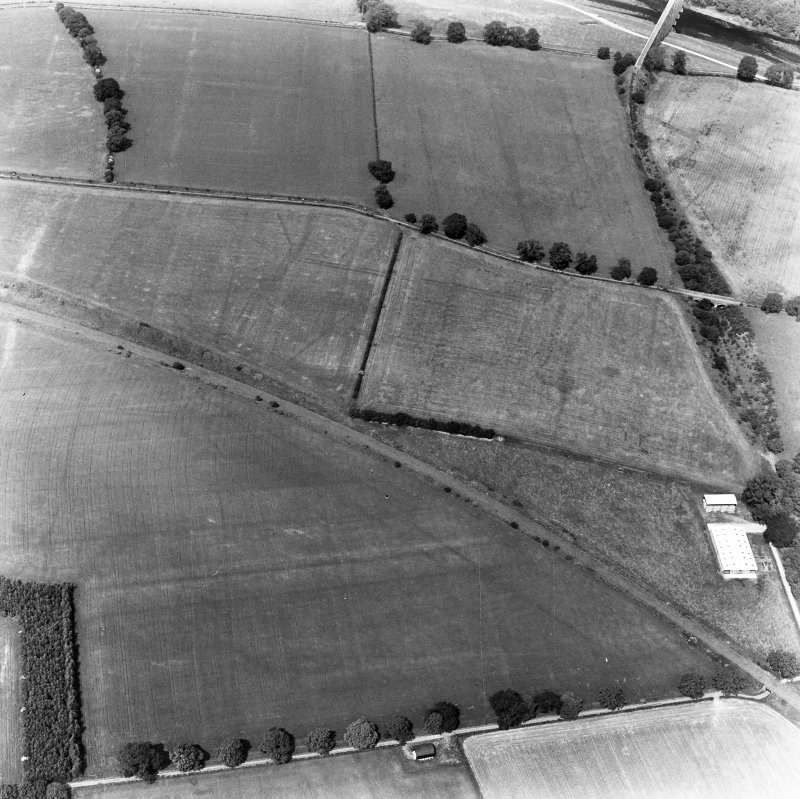 Newstead, Roman forts and temporary camps: RCAHMS air photograph showing southern annexe (NT 569 341), eastern annexe (NT 572 343), annexe (NT 571 343), 'Great camp' complex (NT 574 341) and 40-acre temporary camp (NT 570 337)