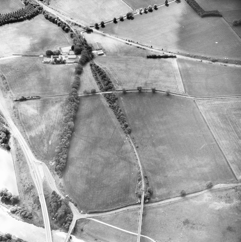 Newstead, Roman fort and temporary camps: air photograph showing Eastern annexe (NT 572 343), annexe (NT 571 343) and 'Great camp' complex of temporary camps (NT 574 341). Also shows pit-alignment and linear feature at Broomhill (NT 576 343 to NT 577 339)