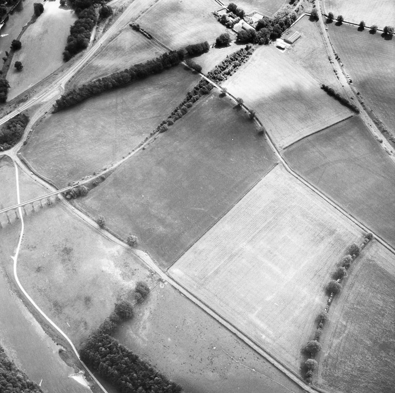 Newstead, Roman fort and temporary camps: air photograph showing fort (NT 569 344), Southern annexe (NT 569 341), Eastern annexe (NT 572 343), annexe (NT 571 343), possible annexe (NT 570 346) and 'Great camp' complex of temporary camps (NT 574 341). Also shows enclosure at Broomhill (NT 5734 3422)