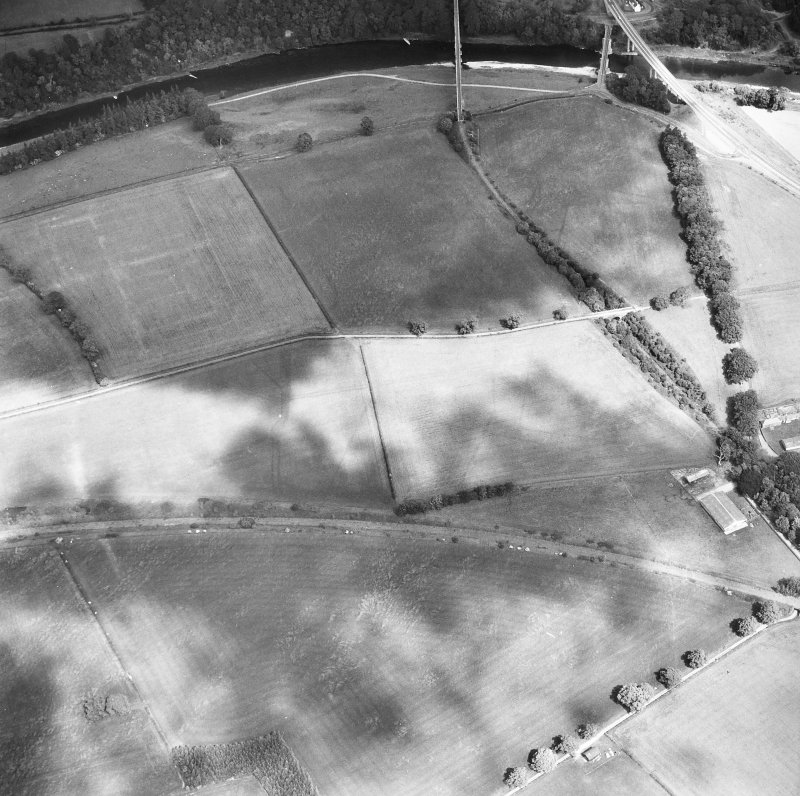 Newstead, Roman fort and temporary camps: air photograph showing fort (NT 569 344), Southern annexe (NT 569 341), Eastern annexe (NT 572 343), annexe (NT 571 343), possible annexe (NT 570 346) and 'Great camp' complex of temporary camps (NT 574 341).