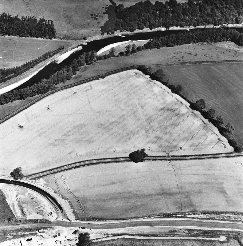 Newstead, oblique aerial view, taken from the SSW, centred on the Roman fort and the western and southern annexes. The Newstead by-pass (under construction) is visible in the bottom half of the photograph.
