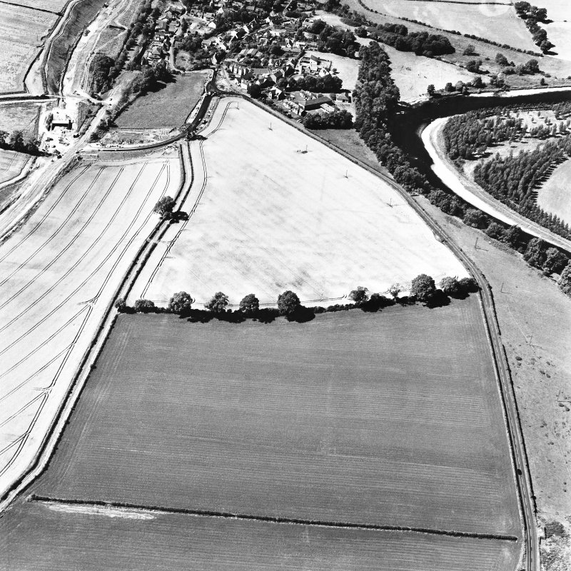 Newstead, oblique aerial view, taken from the ENE, centred on the Roman fort and the western and southern annexes. Newstead village and by-pass (under construction) are visible in the top right-hand corner of the photograph.