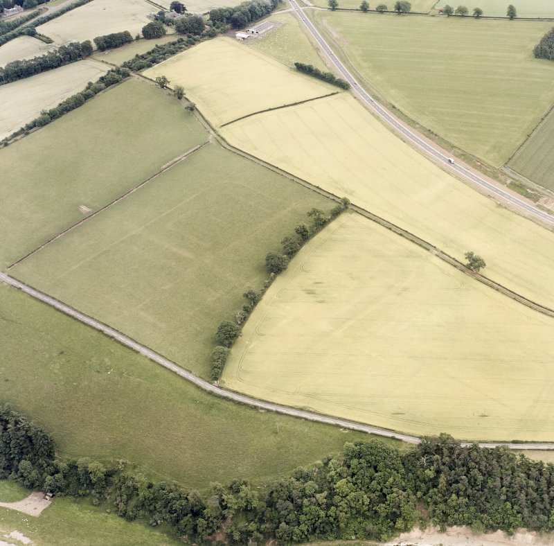 Newstead, oblique aerial view, taken from the NW, centred on the Roman fort and western annexe.