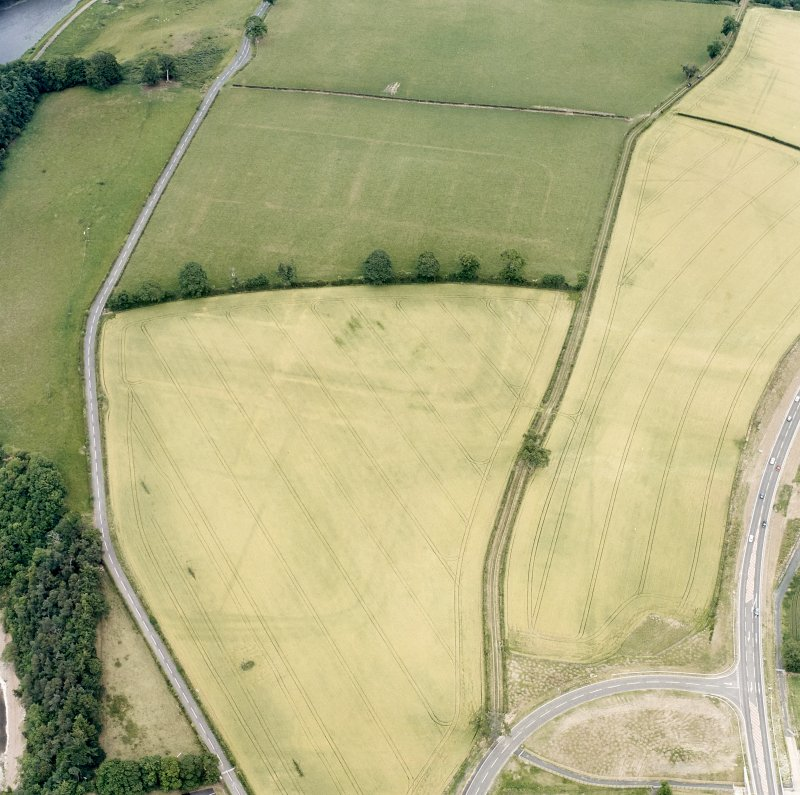 Newstead, oblique aerial view, taken from the WSW, centred on the Roman fort and western annexe.