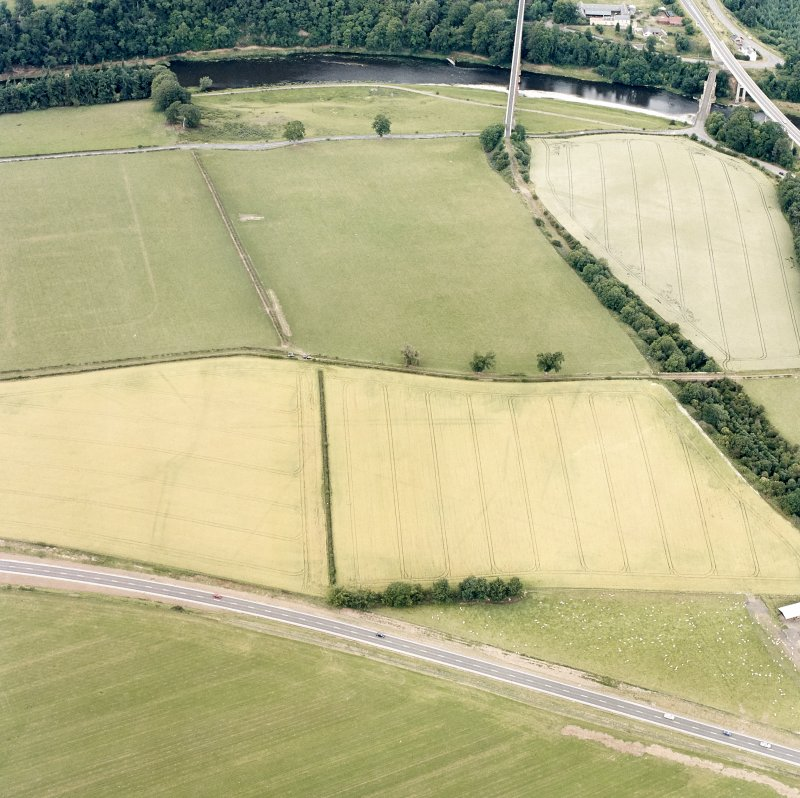 Newstead, oblique aerial view, taken from the S, centred on the Roman fort eastern annexe and 'great camps' complex.