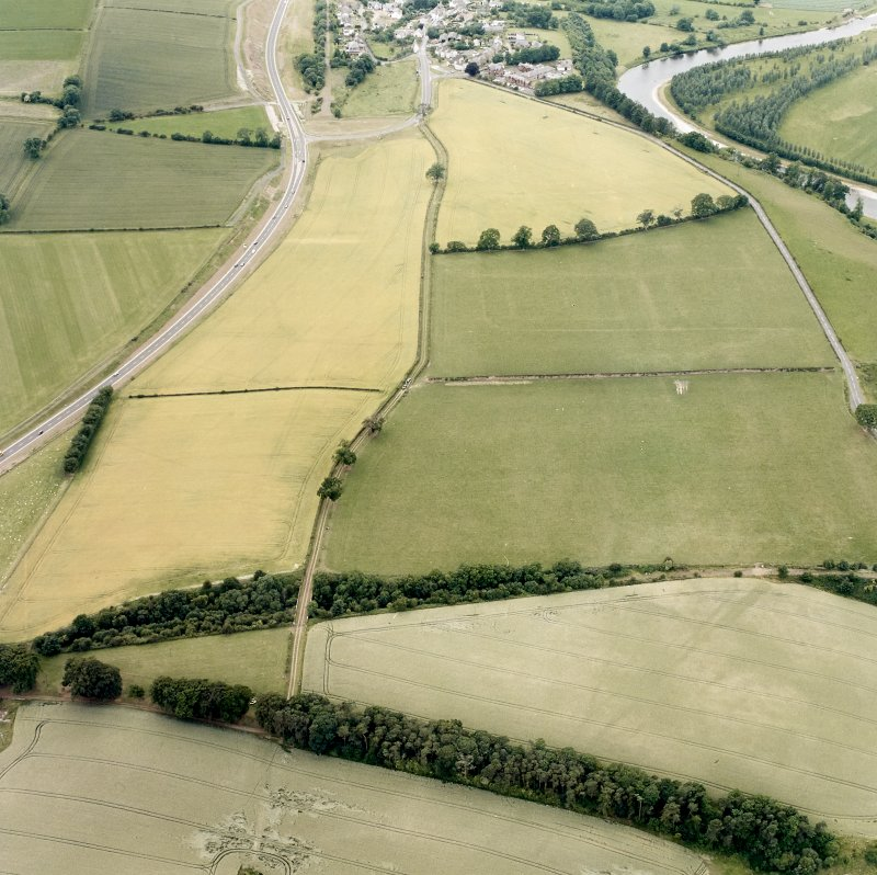 Newstead, oblique aerial view, taken from the E, centred on the Roman fort and annexes.