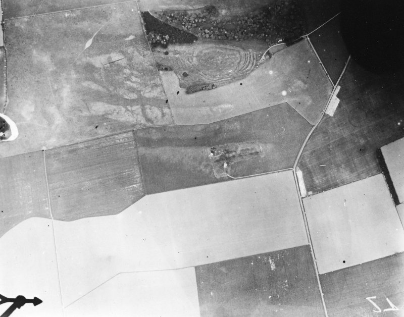 Vertical aerial view of The Chesters, Drem showing the fort, a circular palisaded settlement, a pit-alignment and the W end of a settlement.
