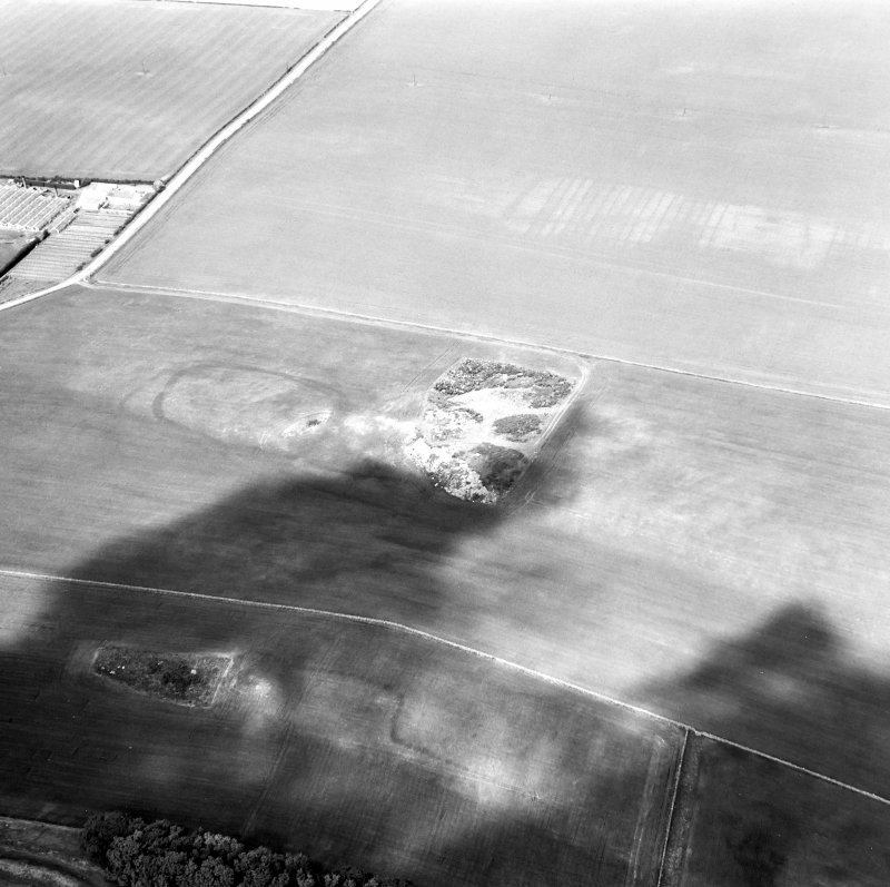 Oblique aerial view showing Foster Law, settlement and The Chesters, pit-alignment cropmarks.