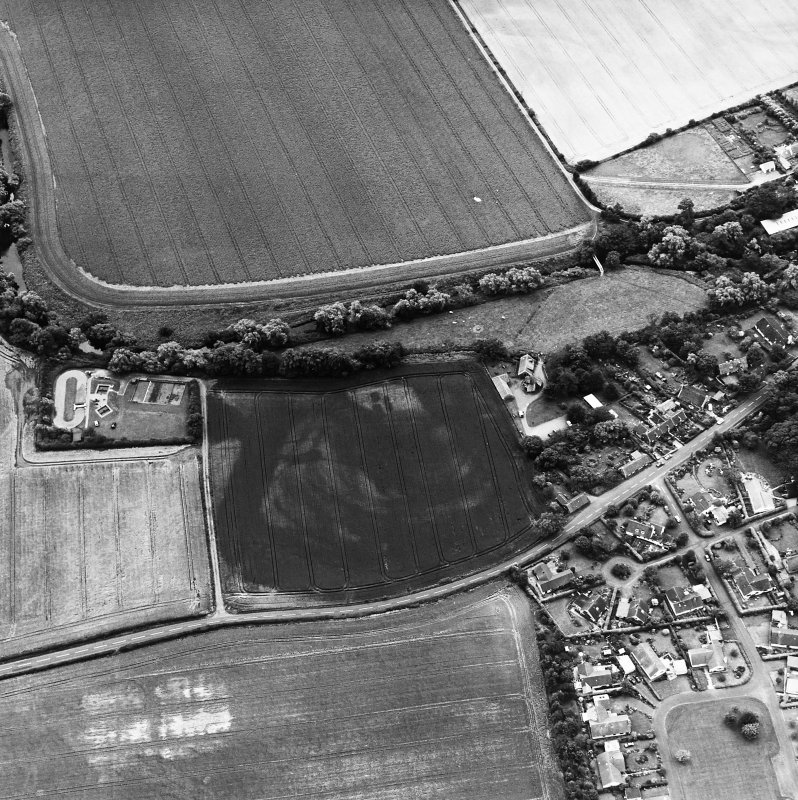 Preston Mill, oblique aerial view, taken from the N, centred on cropmarks including a possible settlement. Preston Mill is visible in the centre of the photograph.