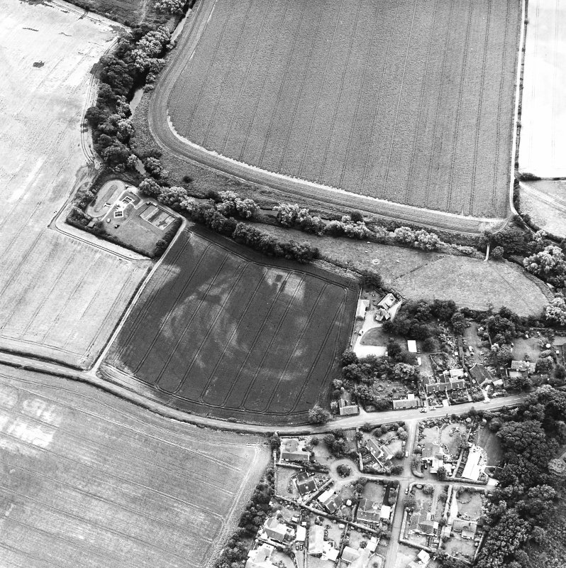 Preston Mill, oblique aerial view, taken from the NW, centred on cropmarks including a possible settlement. Preston Mill is visible in the centre of the photograph.