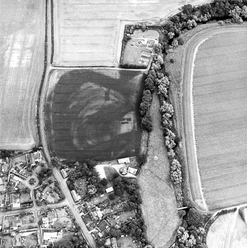 Preston Mill, oblique aerial view, taken from the SW, centred on cropmarks including a possible settlement. Preston Mill is visible in the centre of the photograph.
