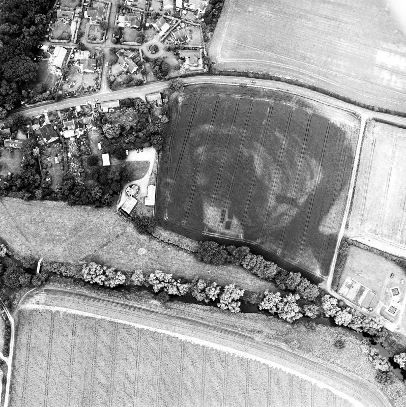 Preston Mill, oblique aerial view, taken from the SE, centred on cropmarks including a possible settlement. Preston Mill is visible in the centre of the photograph.