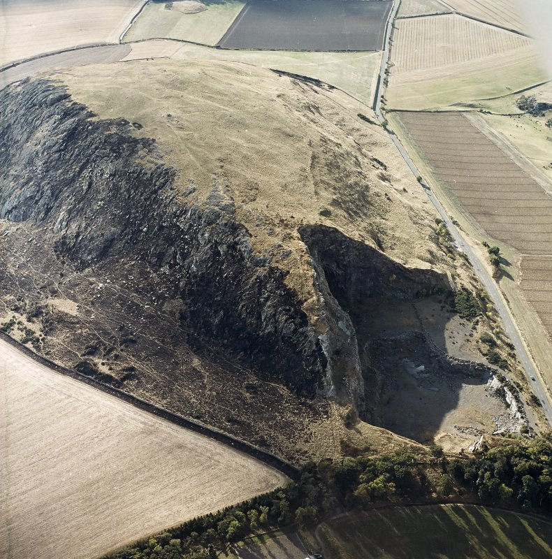Oblique aerial view centred on the remains of the fort showing recent fire damage, taken from the E.