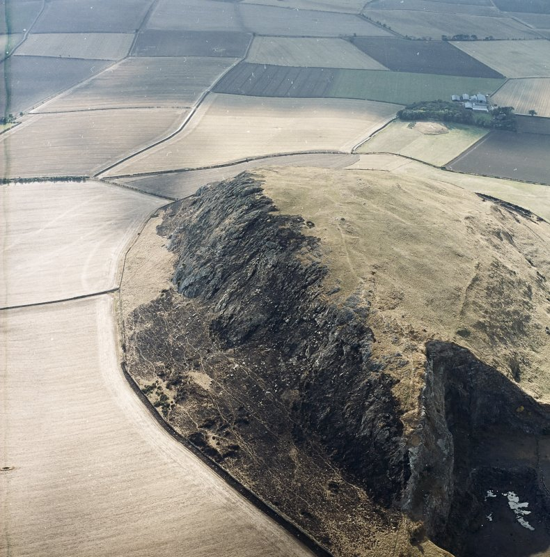 Oblique aerial view centred on the remains of the fort showing recent fire damage, taken from the ENE.