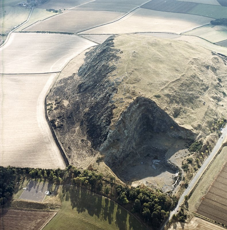 Oblique aerial view centred on the remains of the fort showing recent fire damage, taken from the NE.
