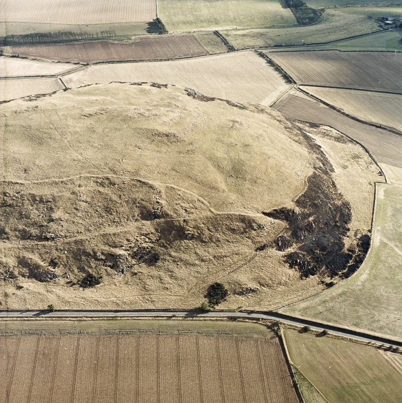Oblique aerial view centred on the remains of the fort showing recent fire damage, taken from the NNW.