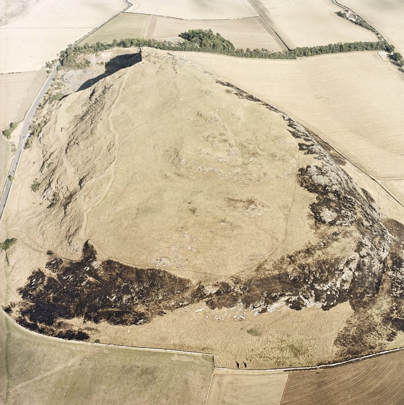 Oblique aerial view centred on the remains of the fort showing recent fire damage, taken from the W.