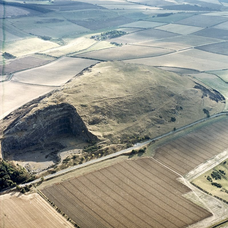 Oblique aerial view centred on the remains of the fort showing recent fire damage, taken from the NNE.