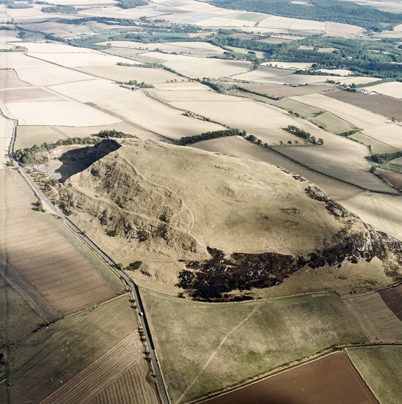 Oblique aerial view centred on the remains of the fort showing recent fire damage, taken from the WNW.