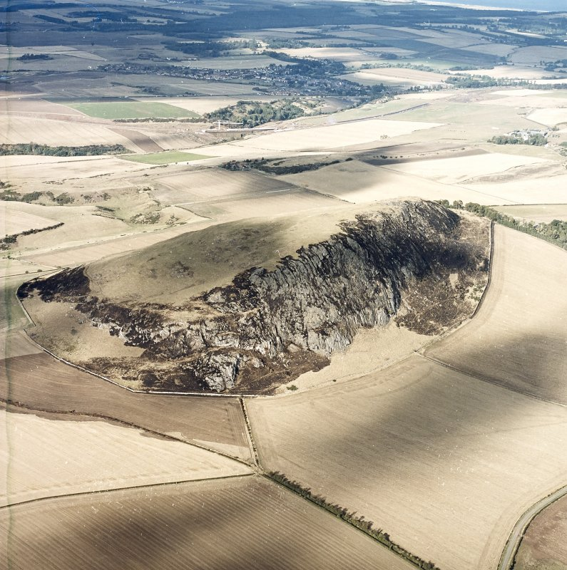 Oblique aerial view centred on the remains of the fort showing recent fire damage, taken from the SSW.