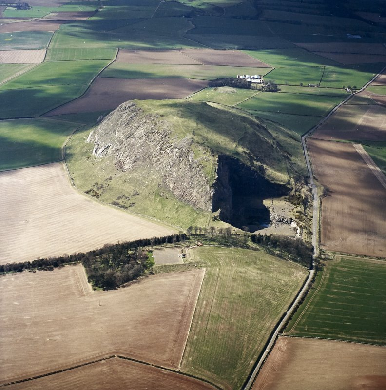 Oblique aerial view centred on the remains of the fort, taken from the ENE.